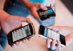 people holding three phones