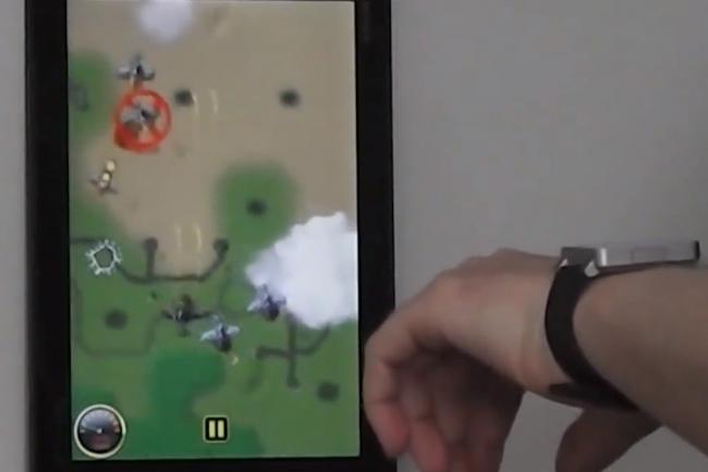 person playing with mobile game