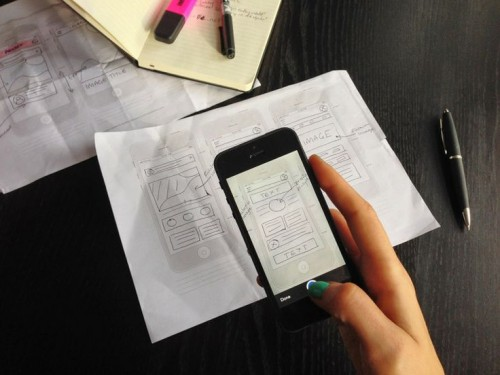 hands with phone and paper