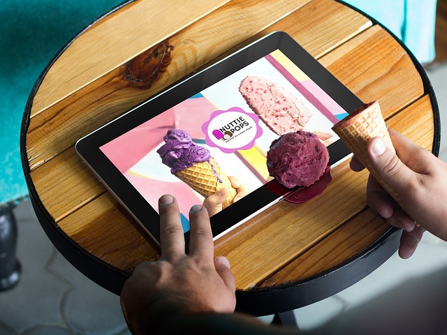 hands with ice-cream and tablet