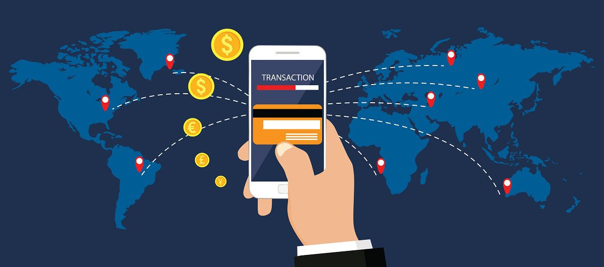 hand holding smartphone with transaction in front of world map