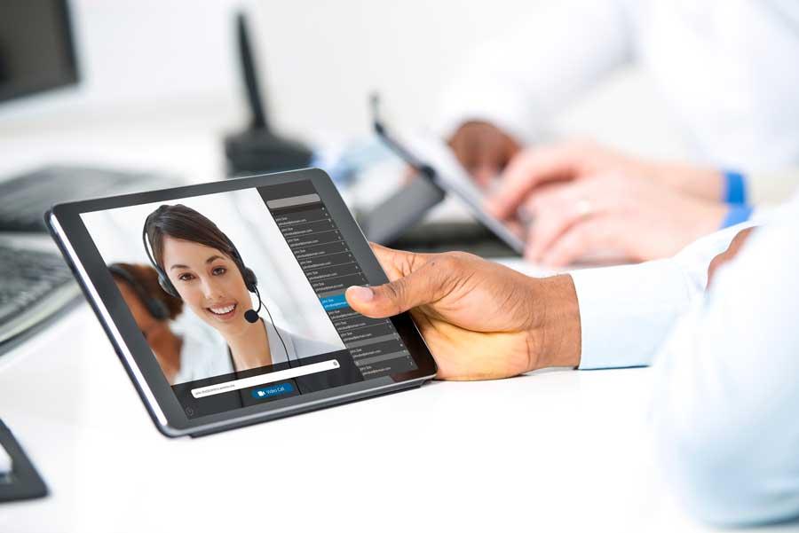 woman with headset on ipad