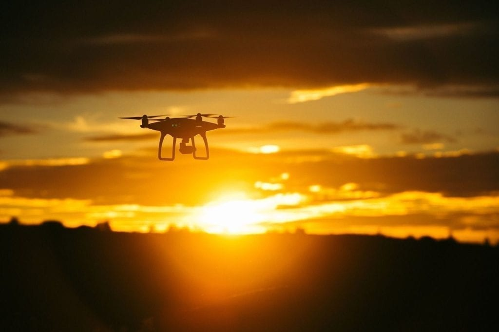 drone flying with sunset