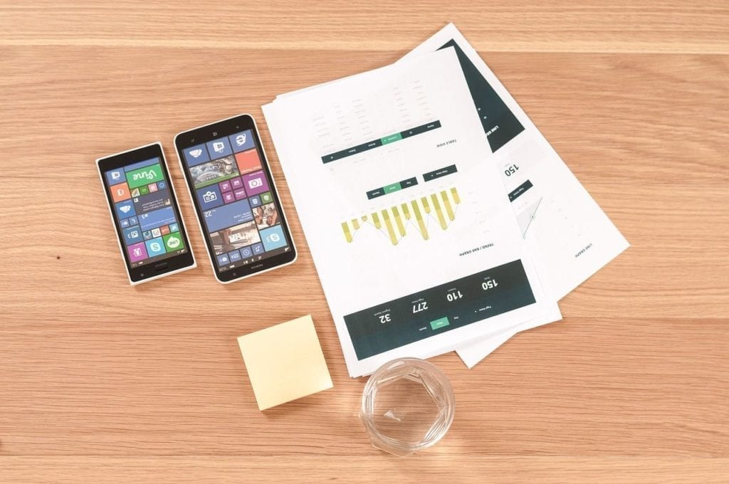 smartphones with papers on the table