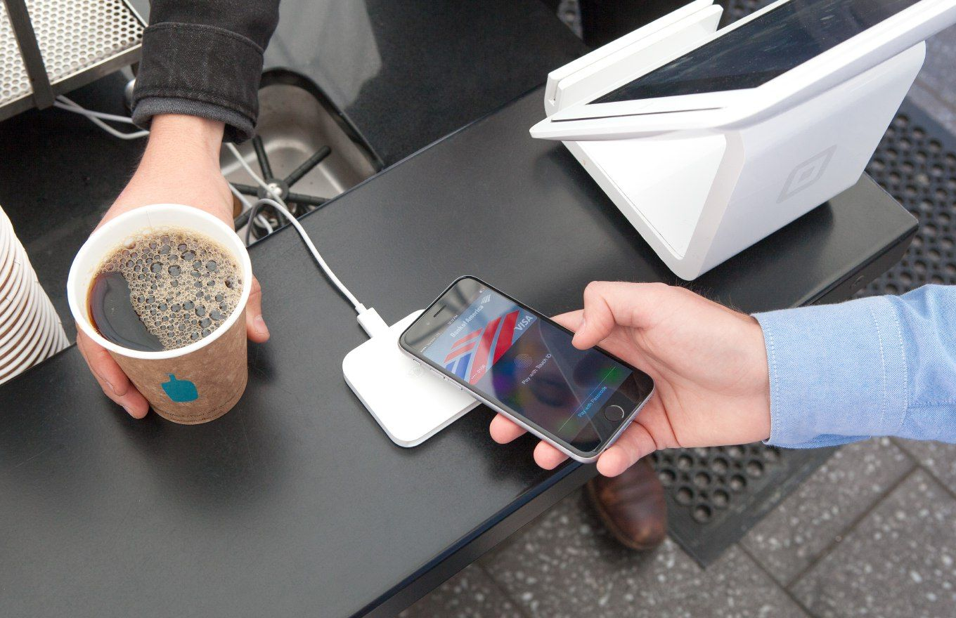 person paying with black iphone
