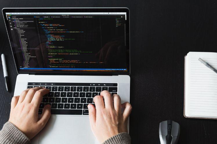 app developer coding on laptop