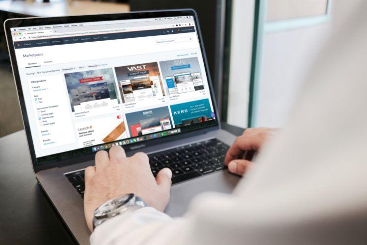 man behind latop- website templates
