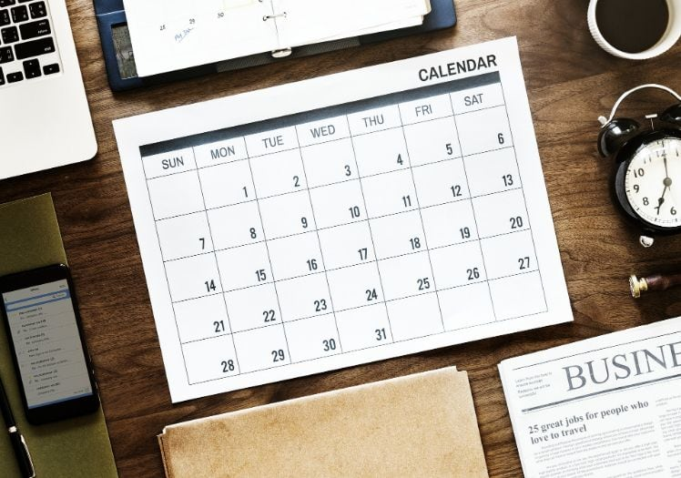calendar on a desk with other office tools