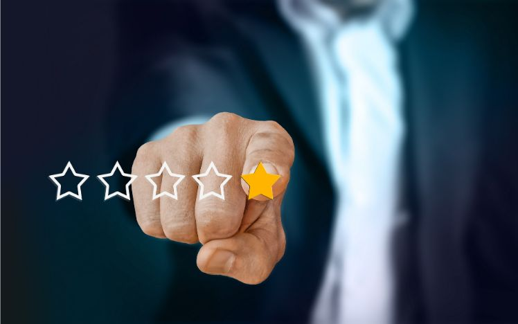 hand pointing to a one star rating