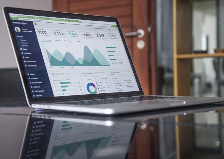 laptop with analytics on a desk