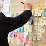 board with post its- project management tools