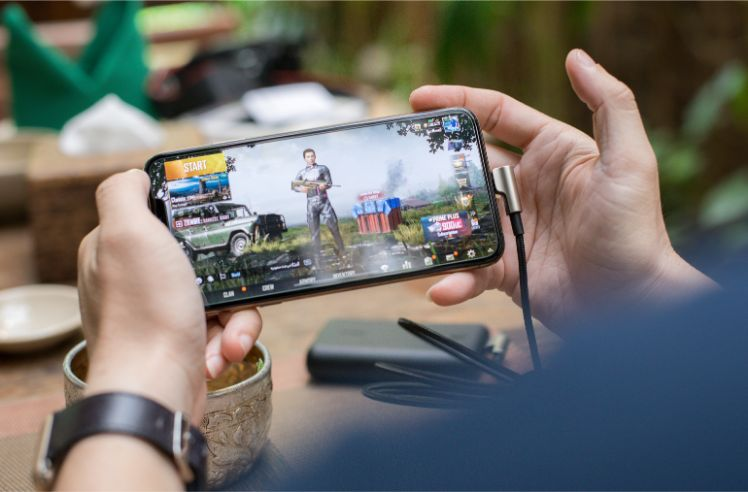 User plays app game on his device - mobile game development