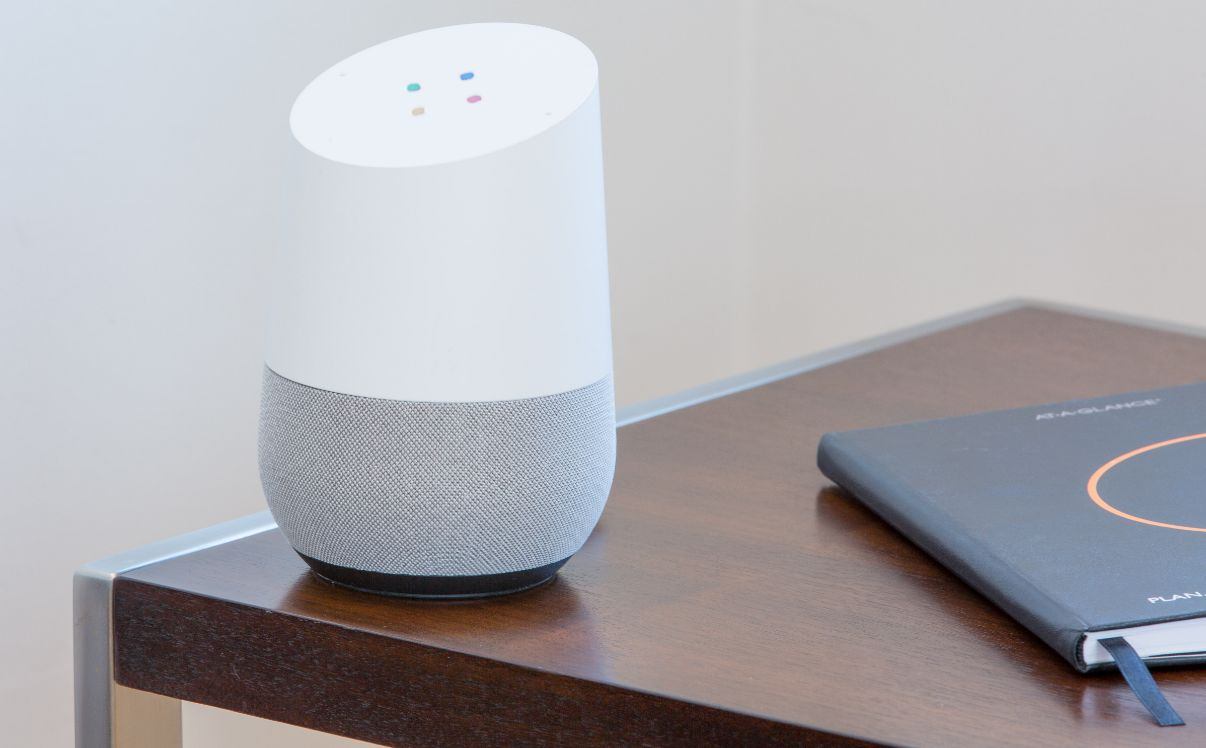 google home device on a table
