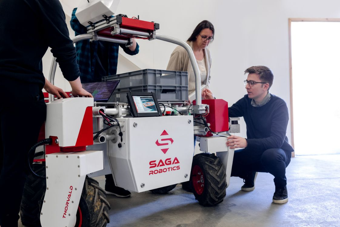 people setting up a robot