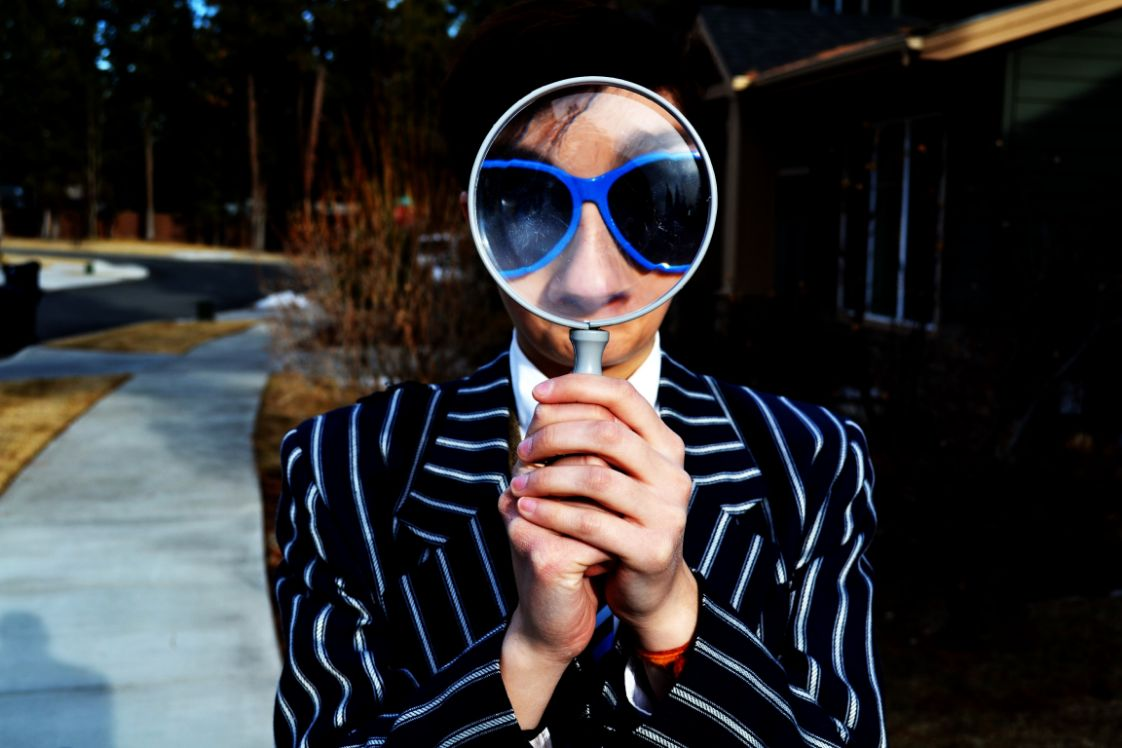 guy holding a magnifying glass