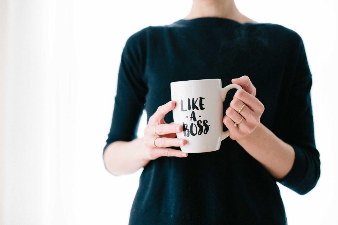 girl holding a boss mug